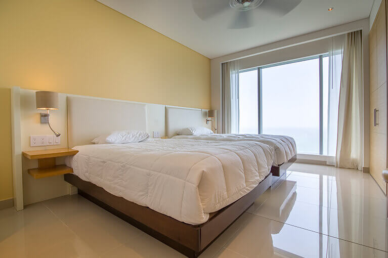 Bedroom with two separate beds at Hyatt Regency Cartagena residential project