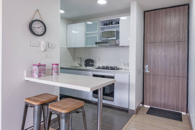 Kitchen in apartment at Urban Salitre residential project in Bogota