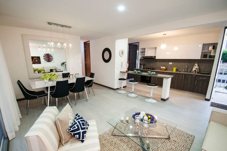 Room and kitchen in the apartment at Ocobo Hacienda Santa Inés residential project in Ibague