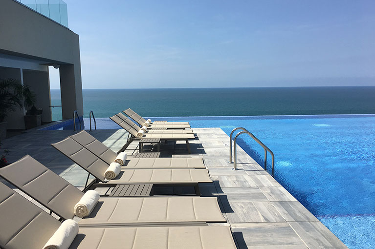 Pool with deck chairs at Hyatt Regency Cartagena residential project